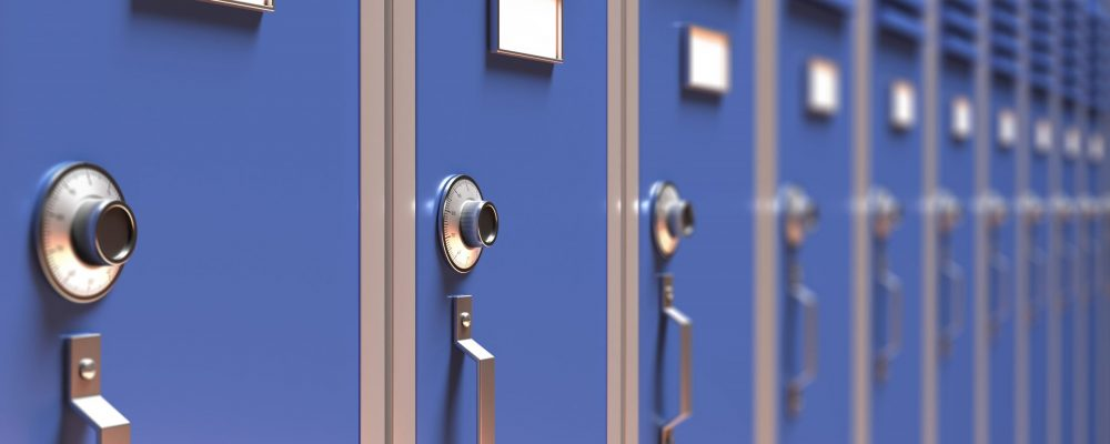 School, gym lockers closeup, perspective view. Students storage cabinets, blue color, closed metal door detail with combination lock and blank white tag. 3d illustration
